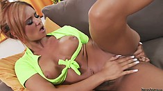 Ashley Bulgari fingering and playing with a dildo in a hot porn video