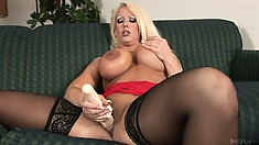 Giant tits and hairless snatch plowed by her giant toy on the couch