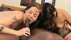 One of the wild babes bounces on his stiff black rod while the other rides his face