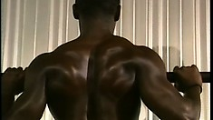 Fully naked, the black dude shows off his awesome ripped body