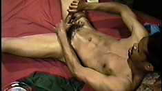 Hot ebony stud lies on the bed and pleases himself until he cums