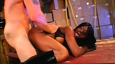 Chubby ebony babe in high vinyl boots gets fucked by a white guy