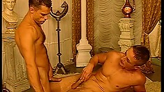 Ripped dudes make each other cum inside of an all-male harem