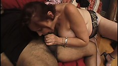 Chubby redhead shows off her big saggy tits and gets nailed in her mature mound