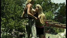 Two naughty blonde ladies with big tits fulfill their lesbian desires in the garden
