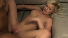 Slim blonde Michelle moves on top of the black stud and rides his cock with fervor