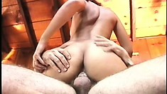 Striking brunette gets on top of her man and wildly rides his hard dick