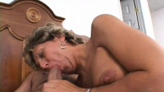 Mature bitch giving head and gets both holes fucked showing her big, pink pussy