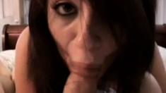 Cute brunette blows a stiff cock until it bursts with pleasure in POV