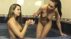 Busty teen lesbians show off their enormous toys and play together