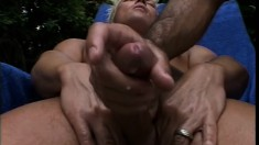 Blonde twink fingers his ass while getting blown out by the pool