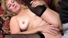Blonde MILF in black stockings gets her tight holes pounded deep