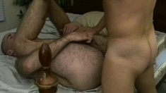 Drew Larson hooks up with two studs on the bed for a gay threesome