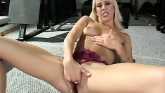 Smoking hot blonde babe teases herself before using a big dildo