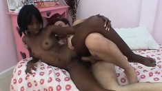 Precious young black babe gets fucked by a white guy all over the bed