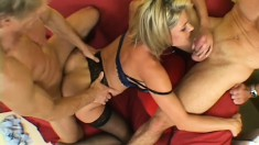 Lustful blonde mom in black stockings has two guys sharing her pussy