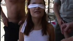 Blindfolded girl with a slim body Saphire Rae sucks and fucks as many cocks as she can