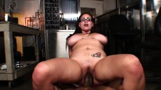 Naughty chick with glasses knows how to use her tits to work a cock