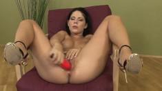Beautiful dark-haired girl enjoys rubbing her wet slit for you