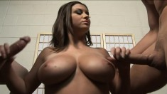 Voluptuous cougar Sara Stone has her skillful hands pleasing two cocks