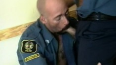Two naughty officers exchange blowjobs and indulge in steamy anal sex