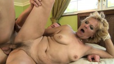 Insatiable blonde GILF gets into a fuck fest with a young buck