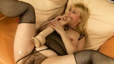 Wild blonde mature Beverly enjoys the time of her life on that couch