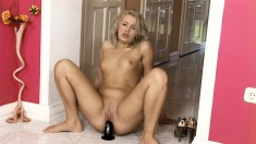 Adorable blonde with a perfect ass works her tight slit on a black toy