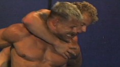 Two muscled buddies turn a wrestling match into a cocksucking session