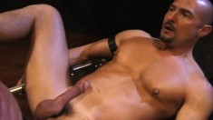 Hot guy with a ripped body spreads his legs for a fist and a hard cock
