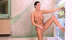 Sexy woman rubs her impressive boobs in the shower room and then masturbates