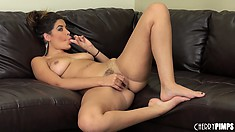 She lies on the couch and starts diddling her cootch, then shows ass