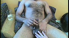 Horny dude with a hairy chest strips off his clothes and sucks a big dick