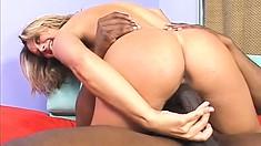 Blonde bimbo gets her pretty face covered in a black guy's hot spunk