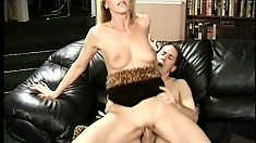 Stacked blonde cougar Nicole sucks and fucks a young stud's big cock with desire