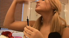 Sexy Corri shows a little cleavage while she puts on her makeup