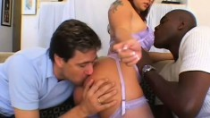 Slutty redhead has a black dude and a white stud hammering her holes