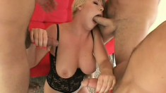Short haired blonde in a kinky outfit gets pounded from both ends