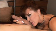 Hot redhead with fake tits gets him hard and fucks him doggy style