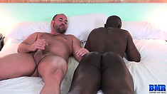 A big slab of ebony meat gets fucked raw by a hung white dude