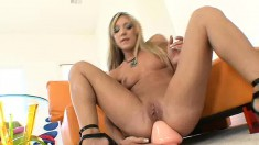 Amy Brooke pounds herself in the ass with the biggest toys she's got