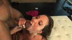 Big breasted Kelly Divine takes a huge black stick up her tight butt