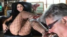 Elegant brunette in fishnets shows off her footjob and blowjob skills