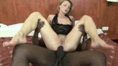 Provoking blonde milf has a black stallion punishing her hungry holes