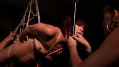 Szilvia is a hot slave and gets strung up to be tortured and finger fucked