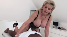 Busty Blonde Milf In Lingerie Works Her Lips And Hands On A Black Dick