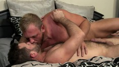 Two muscled gay hunks kiss each other and indulge in exciting anal sex
