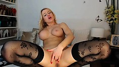 Short haired blonde babe with big boobs sucks big dick