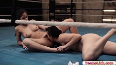 Hot brunette licks and fucks Asians pussy using strap on